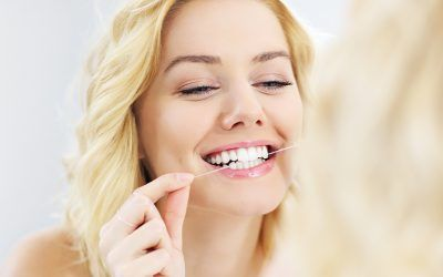 Is Flossing the Way to Avoid Needing Dental Implant in Kent?